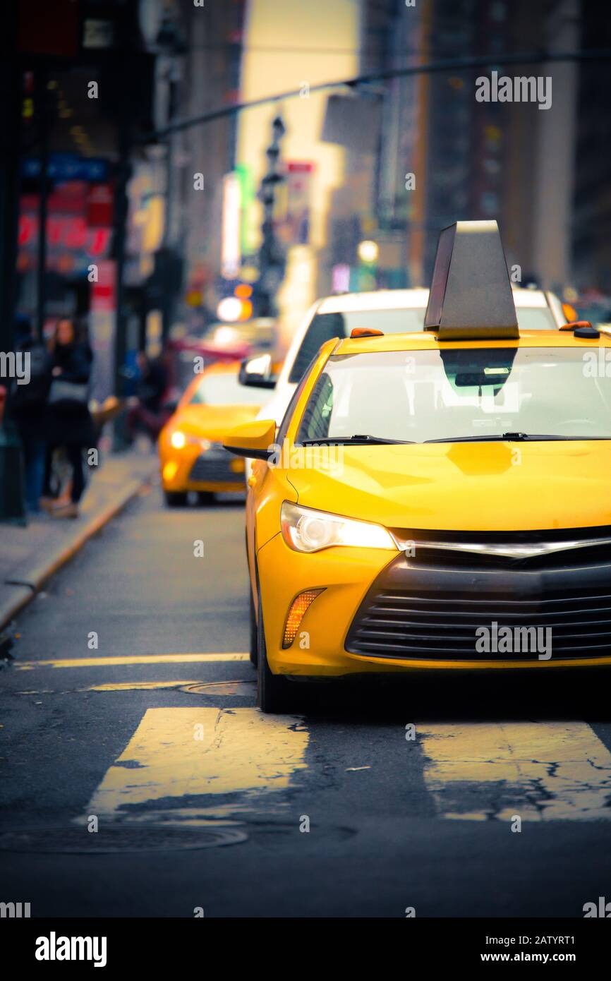 New York City Street scene with iconic yellow taxi cab Stock Photo