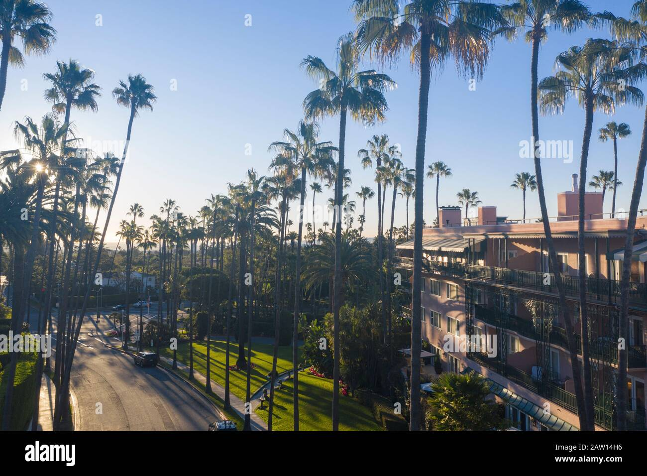 Stunning aerial view of Beverly Hills neighborhood, Beverly Hills Hotel, and Sunset Boulevard surrounded with palm trees in Los Angeles, California. Stock Photo
