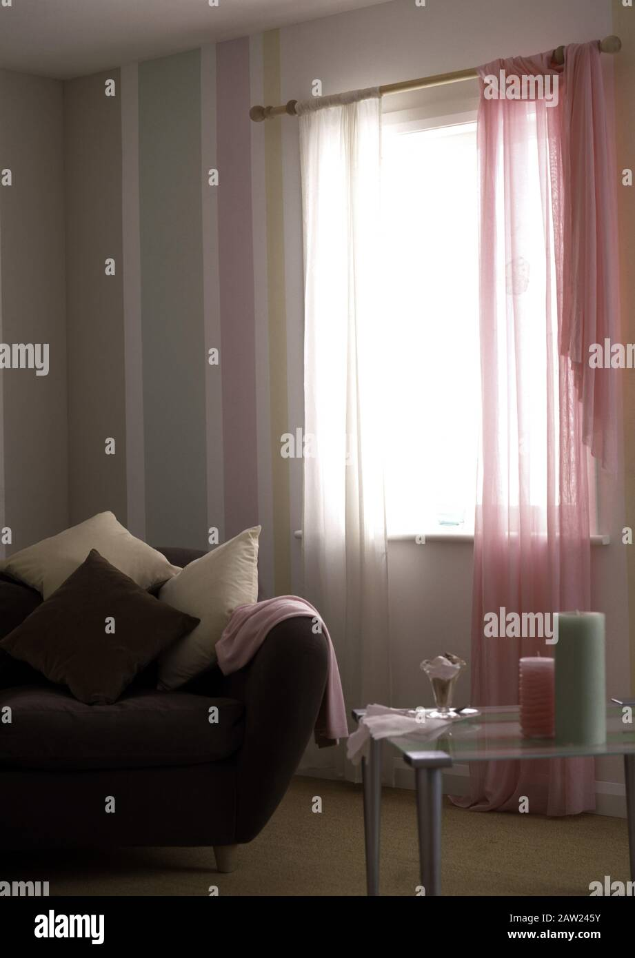 Pink And White Voile Curtains On Window In An Economy Style Living Room With A Modern Sofa Stock Photo Alamy