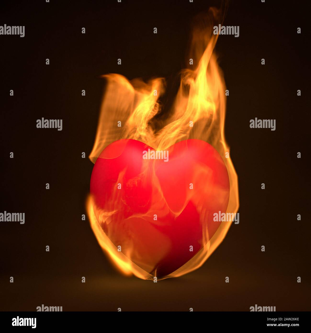 Red heart on fire, burning in flames Stock Photo