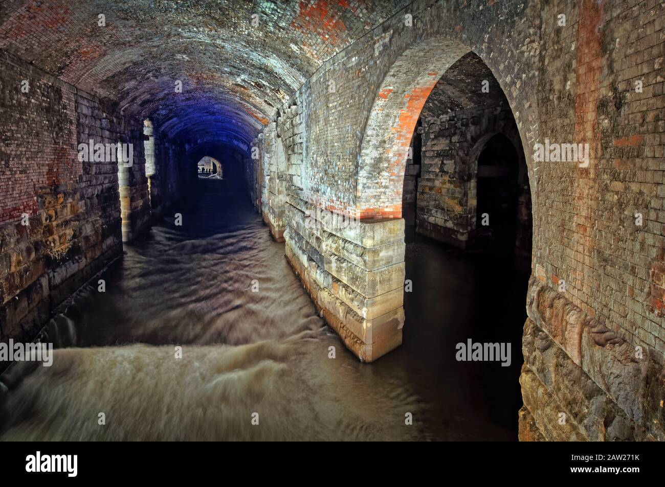 UK,West Yorkshire,Leeds,Granary Wharf,The Dark Arches tunnel complex underneath Leeds Railway Station. Stock Photo