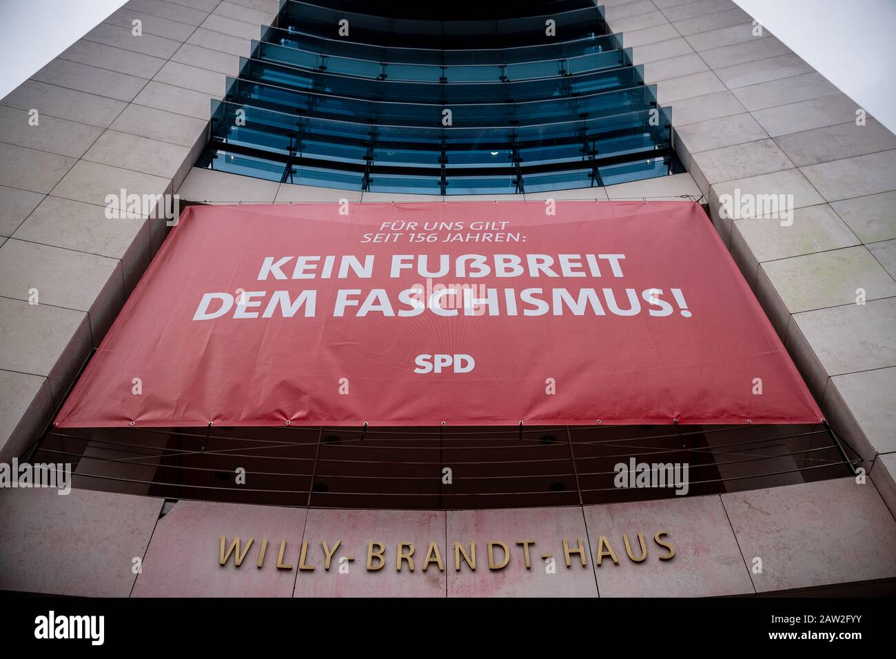 "Berlin, Germany. 06th Feb, 2020. A banner with the inscription ""Kein Fußbreit dem Faschismus!"" hangs on the facade of the SPD headquarters, the Willy Brandt House. With the banner, the SPD refers to the controversial election of the Minister President in Thuringia. Credit: Michael Kappeler/dpa/Alamy Live News Stock Photo"