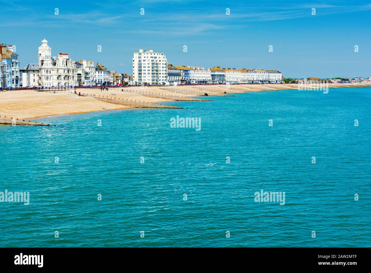 EASTBOURNE, EAST SUSSEX, UK - MAY 23 : View of Eastbourne town seafront, houses and beach from the pier in East Sussex on May 23, 2019 Stock Photo