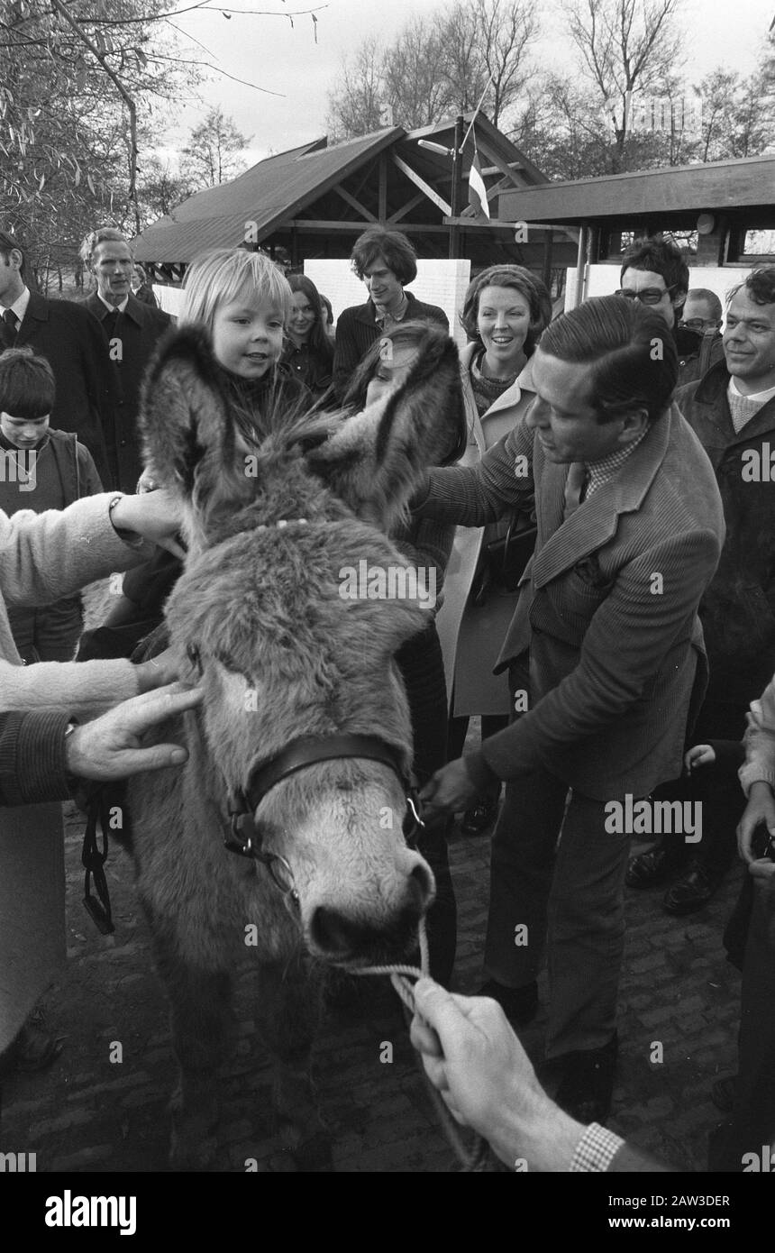 Princess Beatrix and Prince Claus and their children at the opening of children's Free Rein in Soest  Prince Claus puts Constantine on a donkey, on the background Princess Beatrix Date: November 17, 1973 location: Soest, Utrecht (prov.) Keywords: donkey, petting zoos, children, holes, princes, princesses Person Name: Beatrix, princess, Claus, prince Constantijn, prince Stock Photo
