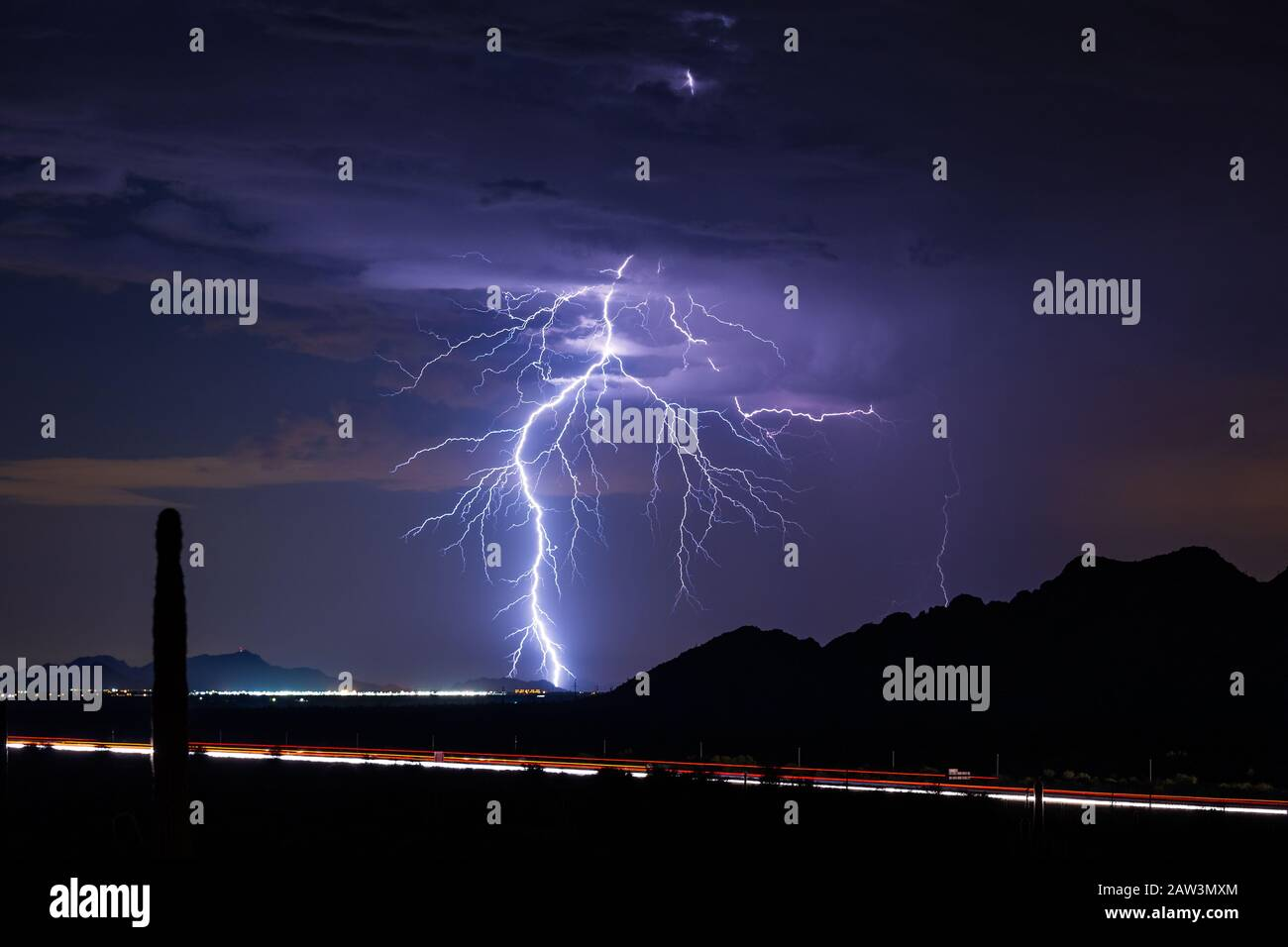 A bright lightning bolt strikes from a monsoon storm over Eloy, Arizona. Stock Photo