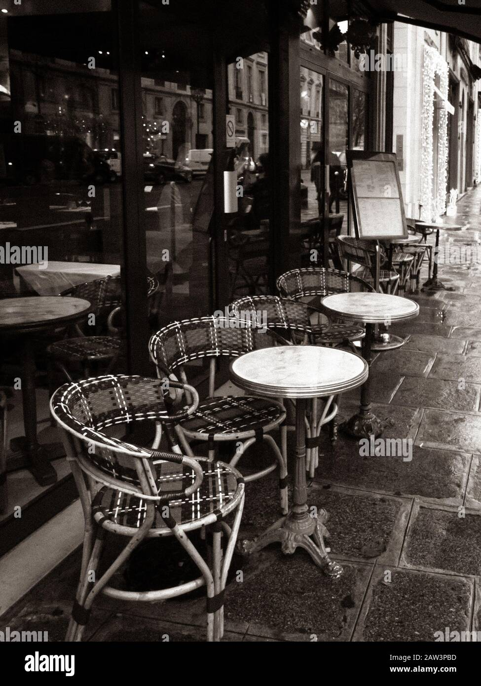 Paris France Parisian Cafe Tables And Chairs On Paved Sidewalk Black And White Photo Stock Photo Alamy