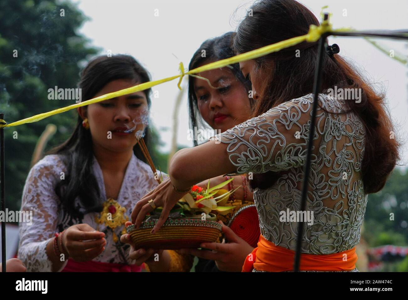 Indonesian Hindus Girls Holding The Offerings During A Big