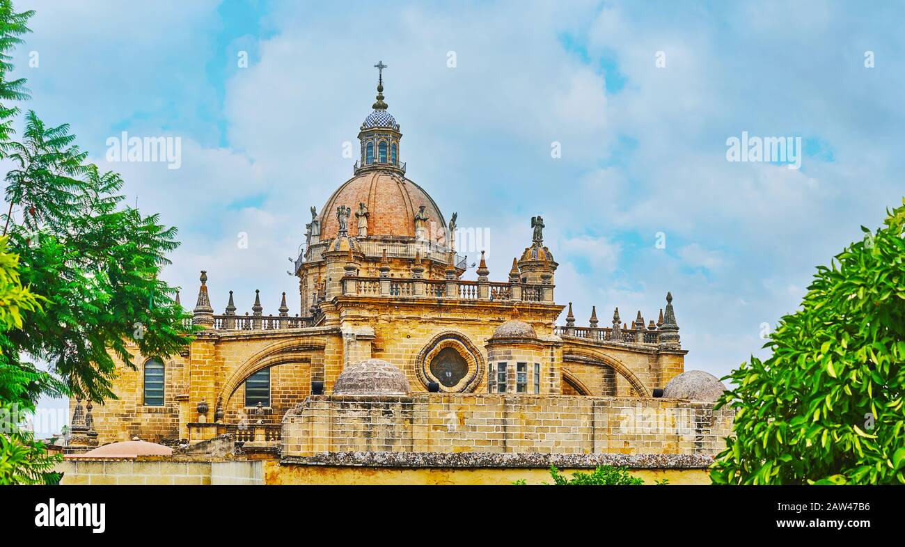 Magnificent medieval dome of Incarnation Cathedral, decorated with stone statues of the saints, geometric tile pattern, carved balusters and massive b Stock Photo
