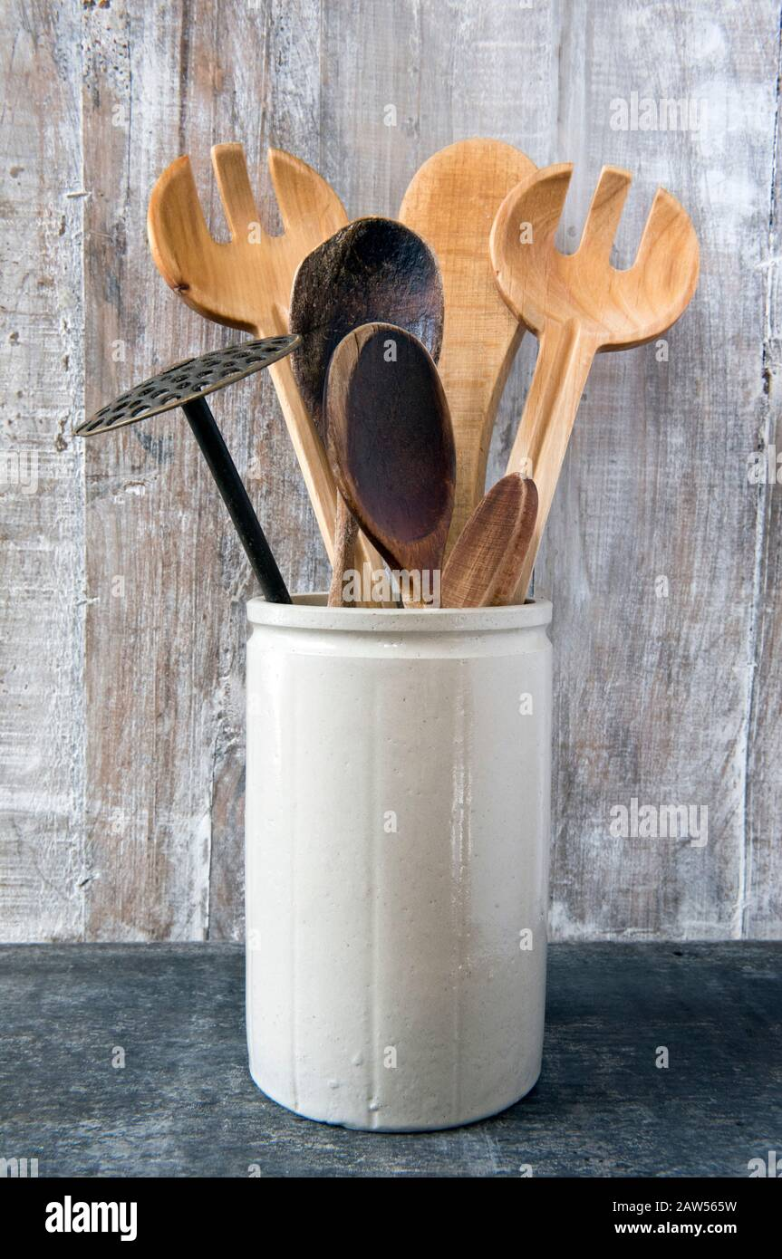 Eco Friendly Kitchen Utensils Including Wooden Spoons In Vintage Pottery Container On Wooden Background Stock Photo Alamy