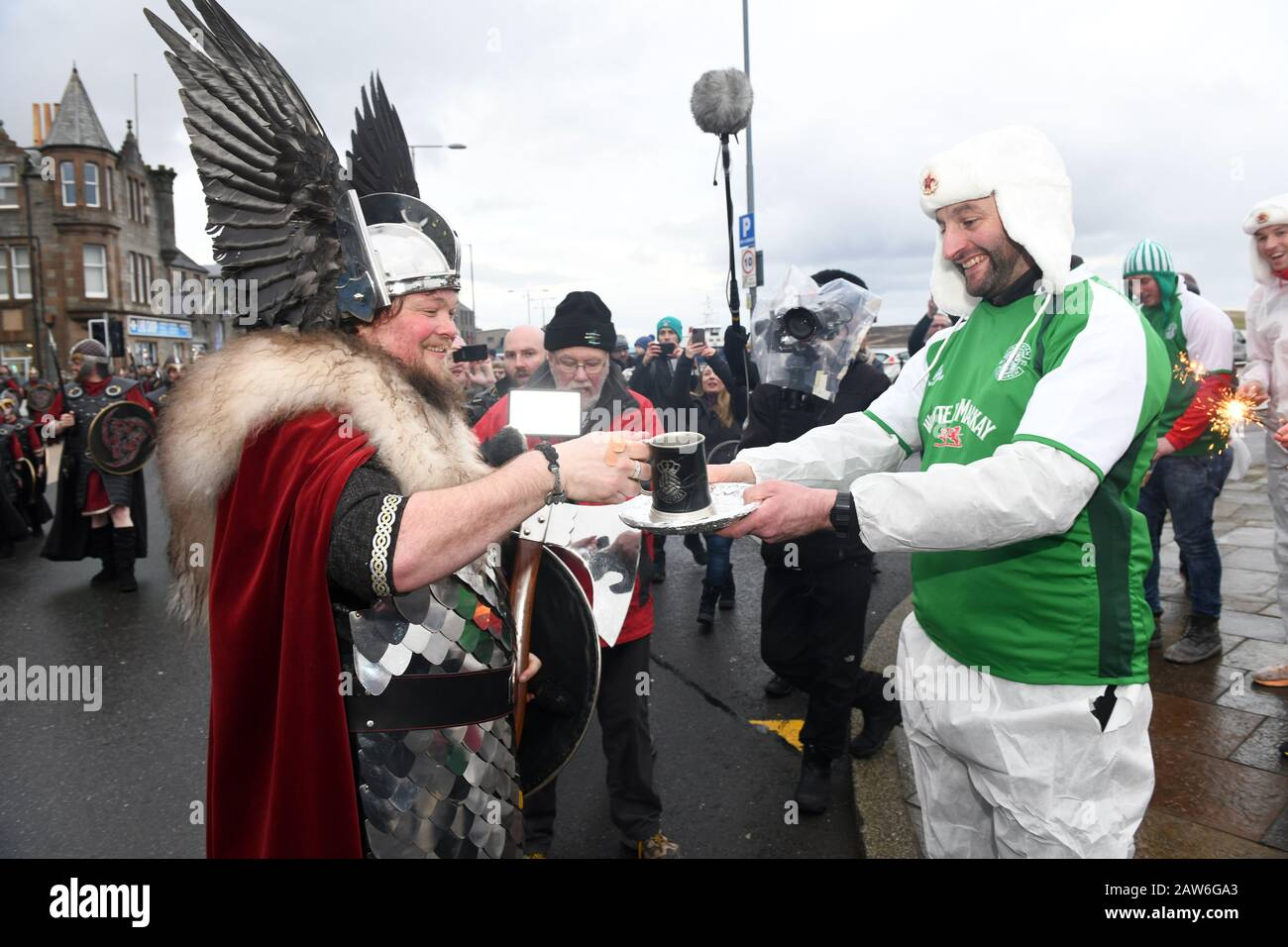 Lerwick Shetland 28th January 2020. Guizer Jarl Liam Summers representing the Norse God Odin leads his squad of guizers through the streets of Lerwick Stock Photo