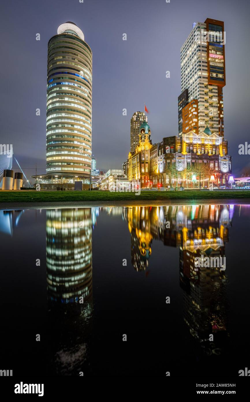 Rotterdam kop van zuid skyline at night, Hotel New York, Montevideo and Rotterdam Harbor tower buildings Stock Photo