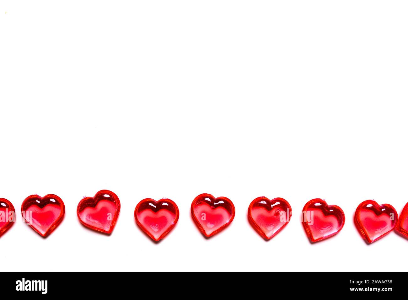 A group of red hearts on a white background with copy space. Valentine's day theme. Stock Photo