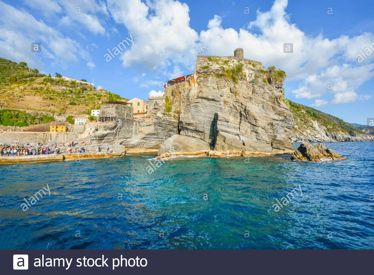 The Castello Doria, the ancient fort along the Ligurian Coast is visible from the sea at the village of Vernazza, Italy, part of the Cinque Terre Stock Photo