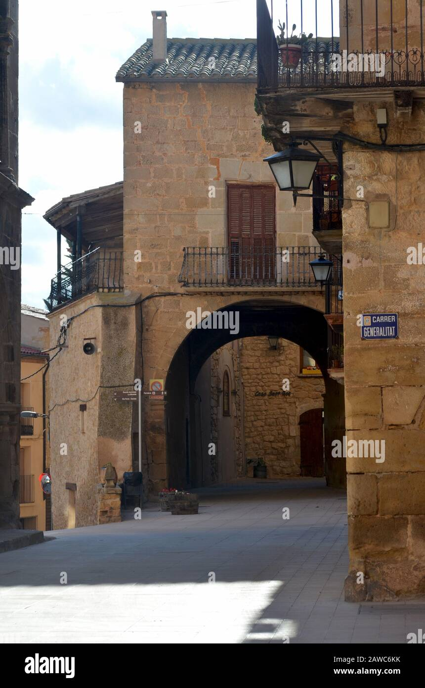 The Renaissance town hall and surrounding cobbled streets of Arnes, a medieval fortified town in Els Ports natural park, Catalonia Stock Photo