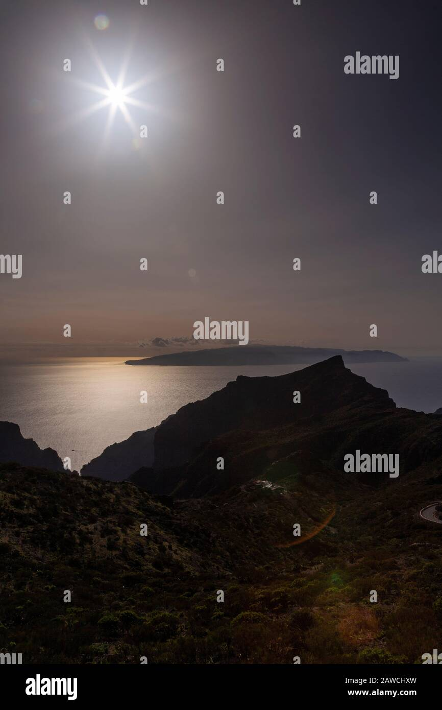Sunburst over La Gomera from Tenerife, Canary Islands Stock Photo