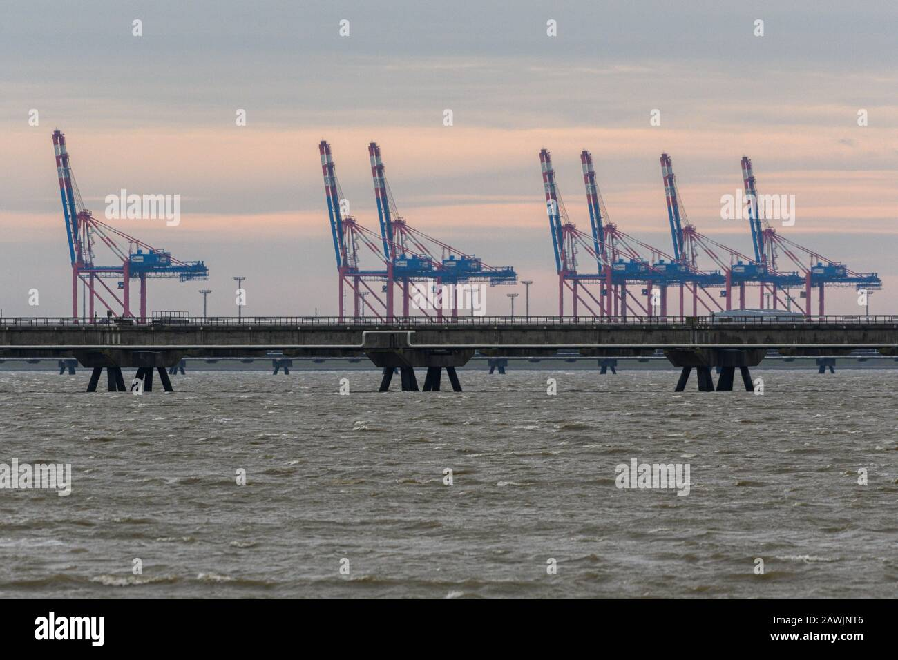 Hooksiel, Germany. 09th Feb, 2020. The cranes of the Jade Weser Port can be seen during the storm from the outer harbour of Hooksiel. Credit: Mohssen Assanimoghaddam/dpa/Alamy Live News Stock Photo