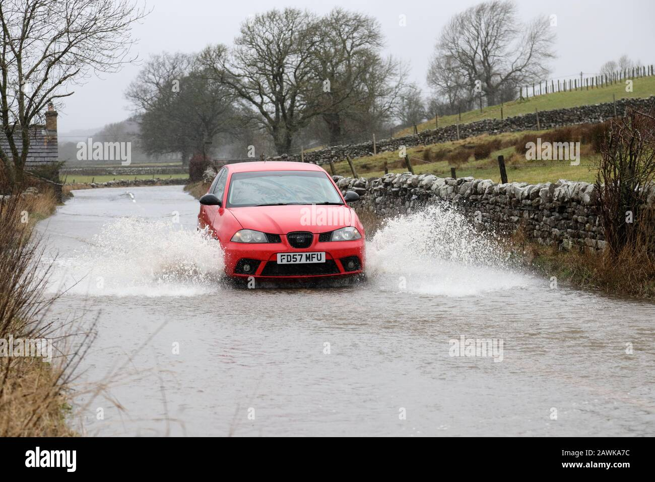 Middleton-in-Teesdale, Teesdale, County Durham, 9th February 2020. UK Weather.  Vehicles battle through floodwater after Storm Ciara caused extensive flooding on roads such as the B6277 near Middleton-in-Teesdale. Credit: David Forster/Alamy Live News Stock Photo
