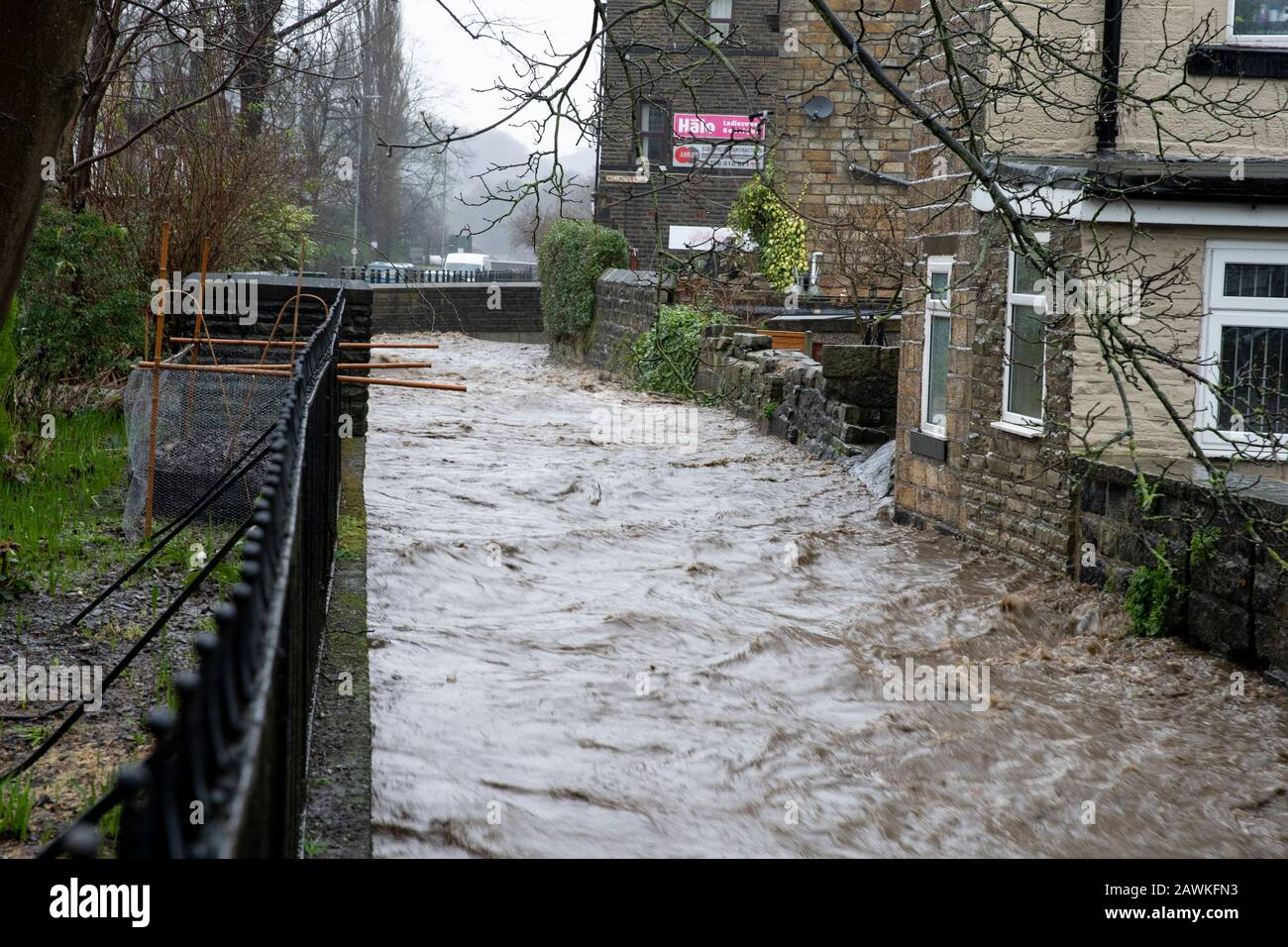 The River Calder almost breaches its banks in Todmorden town centre, West Yorkshire, following high rainfall associated with Storm Ciara. © Craig Redm Stock Photo