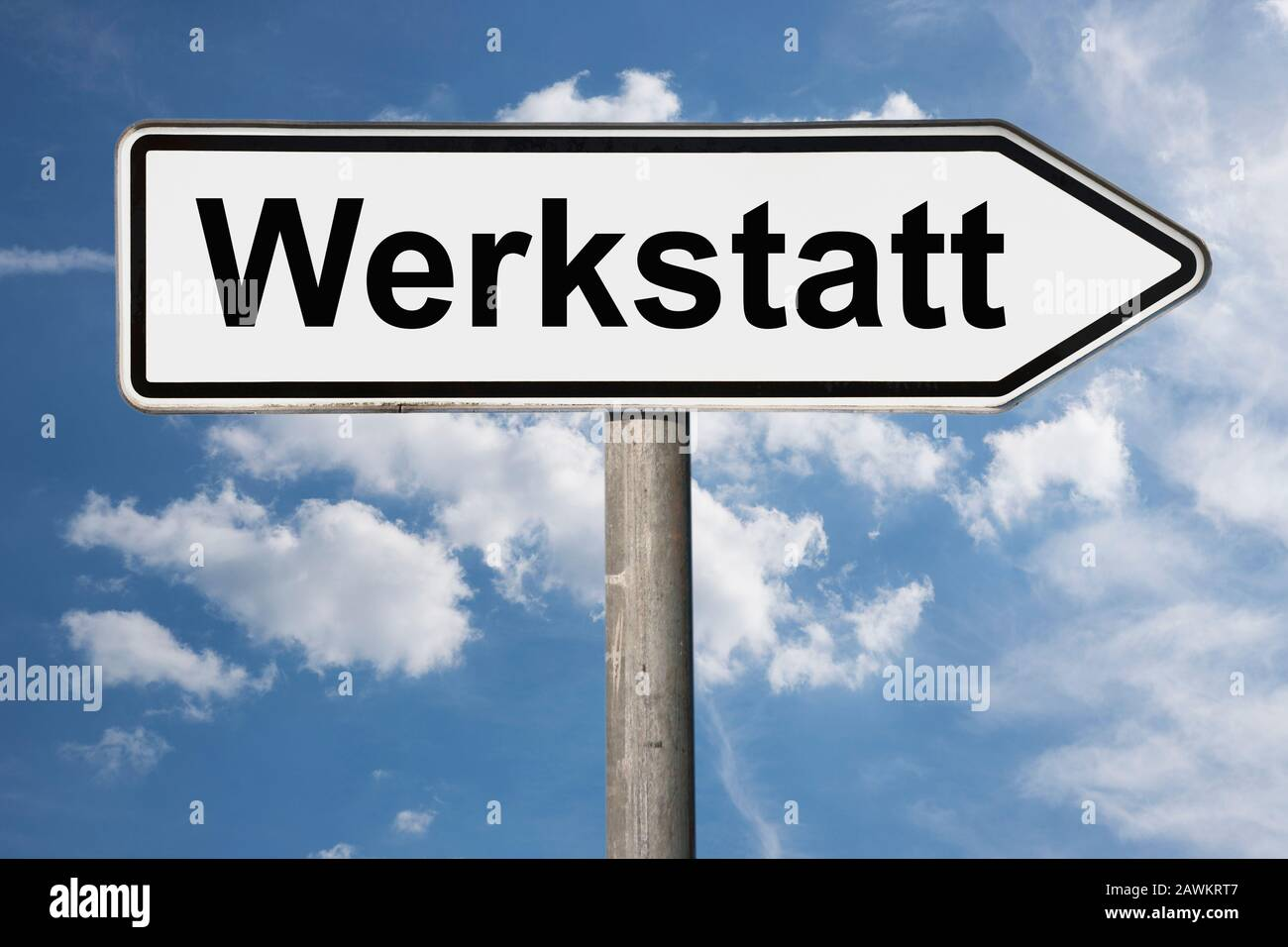 Detail photo of a signpost with the inscription Werkstatt (Workshop) Stock Photo