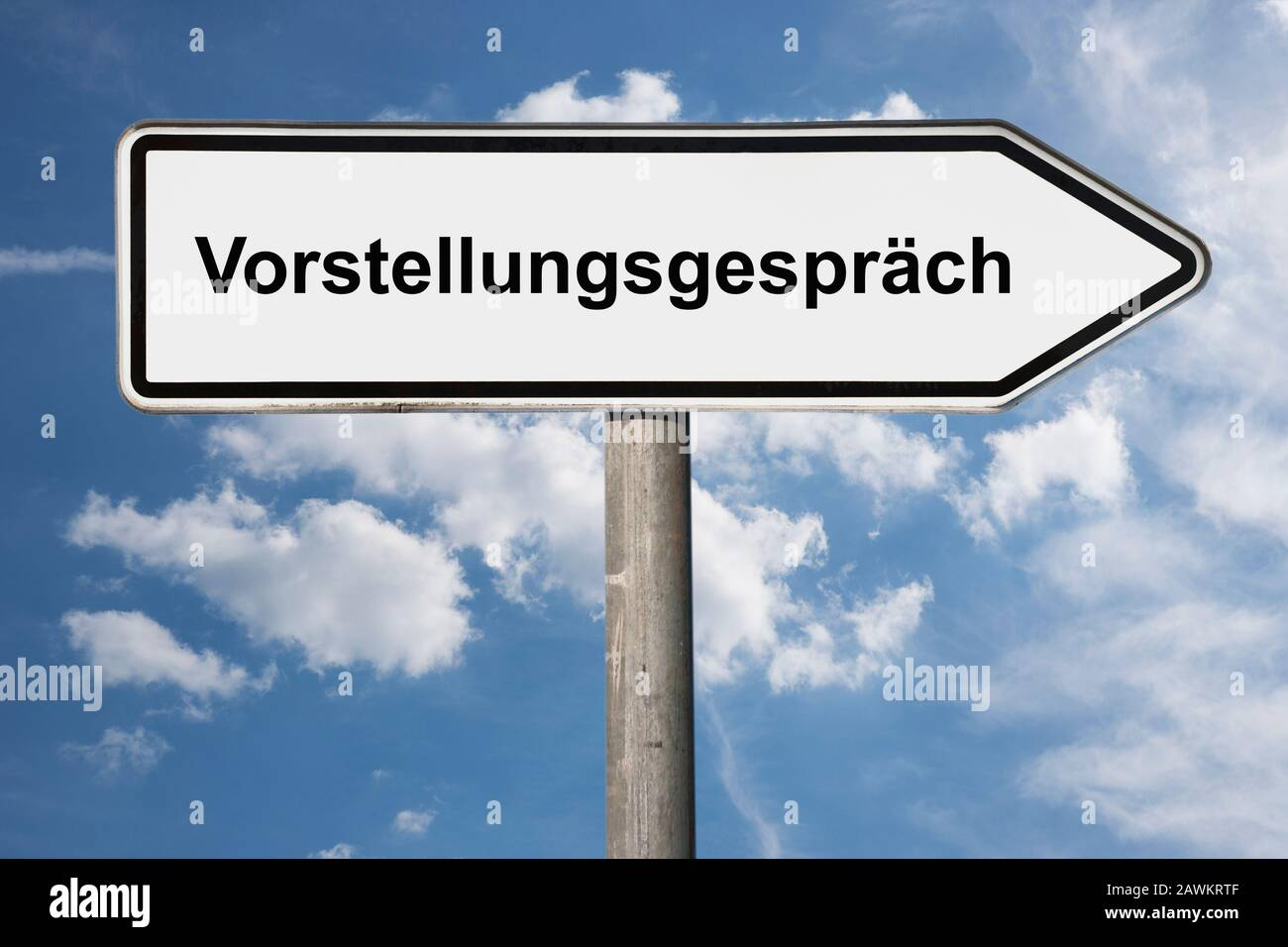 Detail photo of a signpost with the inscription Vorstellungsgespräch (Job interview) Stock Photo