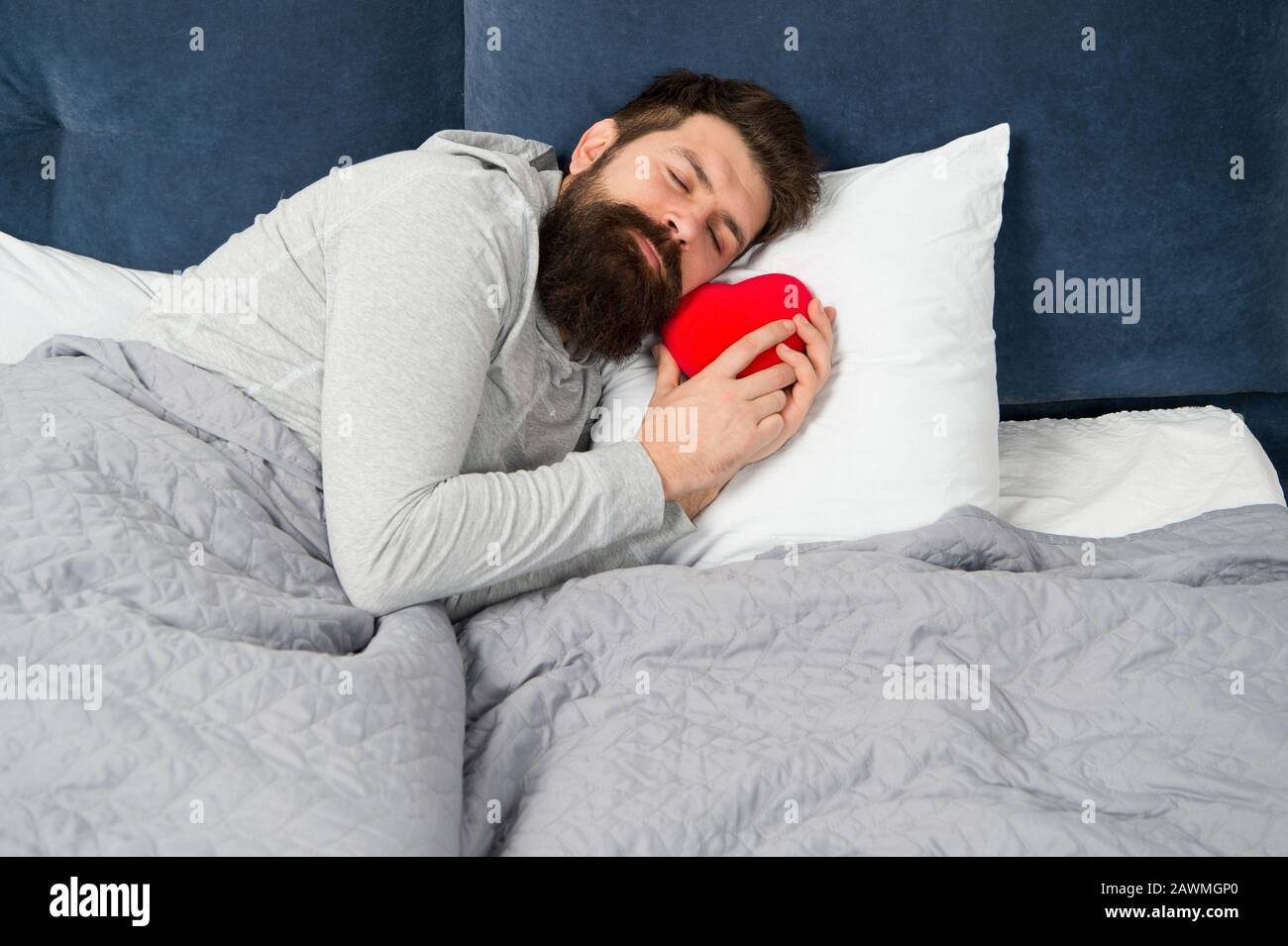 Happy Valentines Day Bearded Man Hold Decoration Heart While Sleeping Heart Full Of Love Start Day With Romantic Hipster With Present Sweet Heart Morning Surprise From His Valentine Stock Photo Alamy