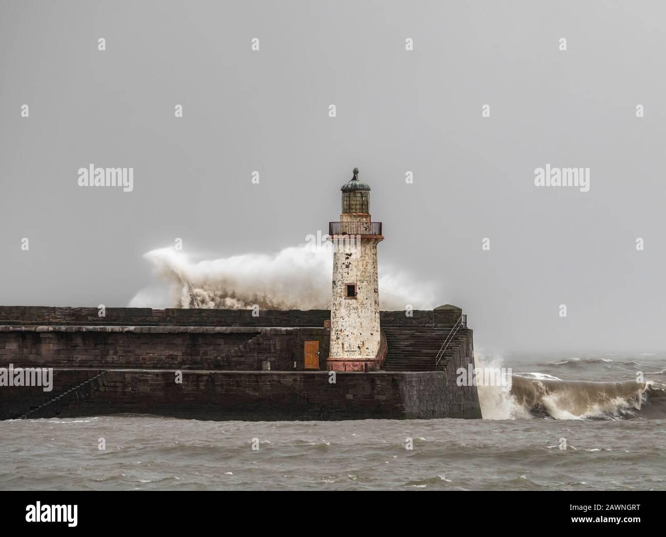Storm Ciara battering a light house on the Cumbrian coast Stock Photo