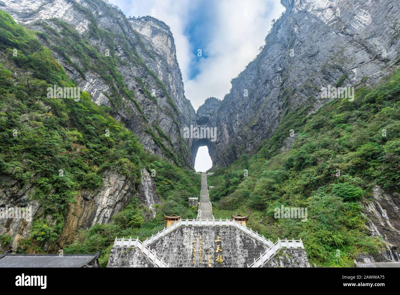 The Heaven's Gate of Tianmen Mountain National Park with 999 step stairway on a cloudy day with blue sky, Zhangjiajie, Changsha, Hunan, China Stock Photo