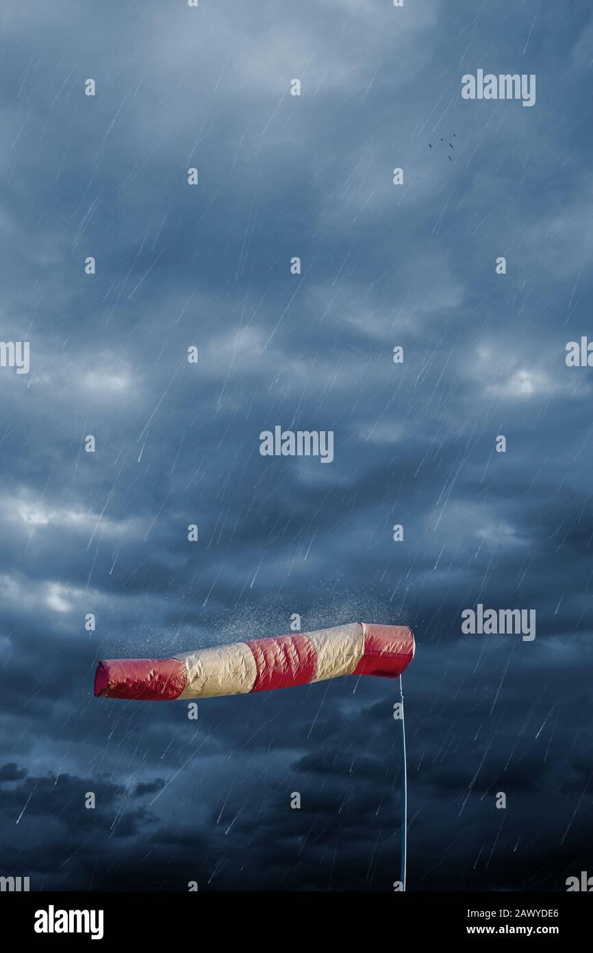 Air sock measuring the wind speed at stormy weather. Hurricane, tornado and storm concept. Stock Photo