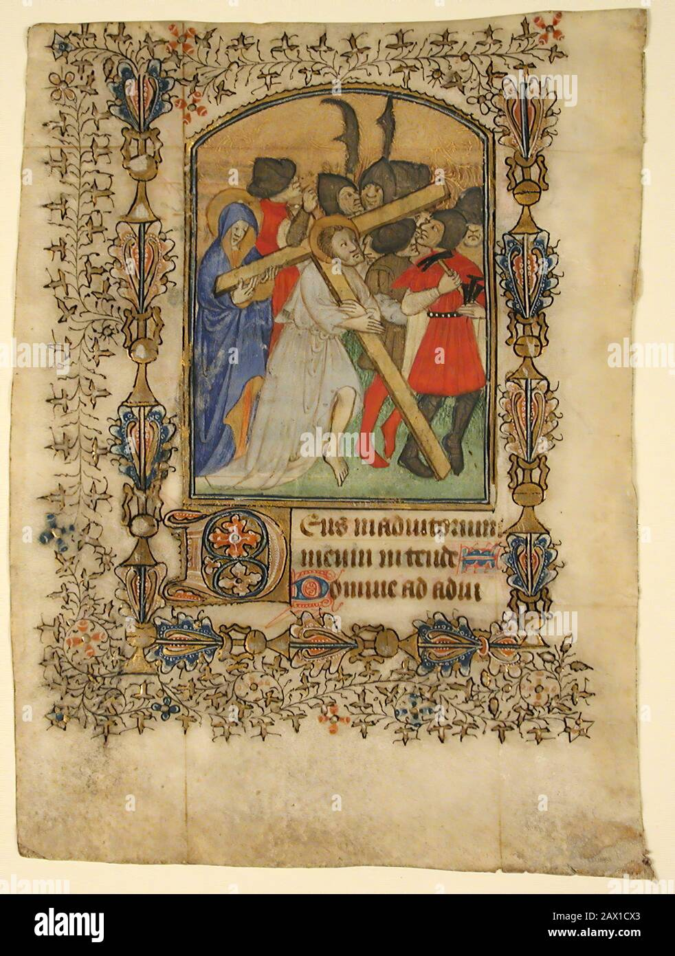Manuscript Leaf from a Book of Hours Showing an Illuminated Initial D and Christ Bearing the Cross, 1390-1400. Stock Photo