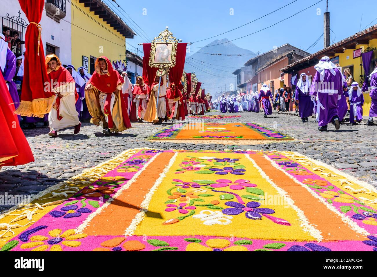 Antigua, Guatemala -  April 14, 2019: Palm Sunday procession & procession carpets in UNESCO World Heritage Site with famed Holy Week celebrations. Stock Photo