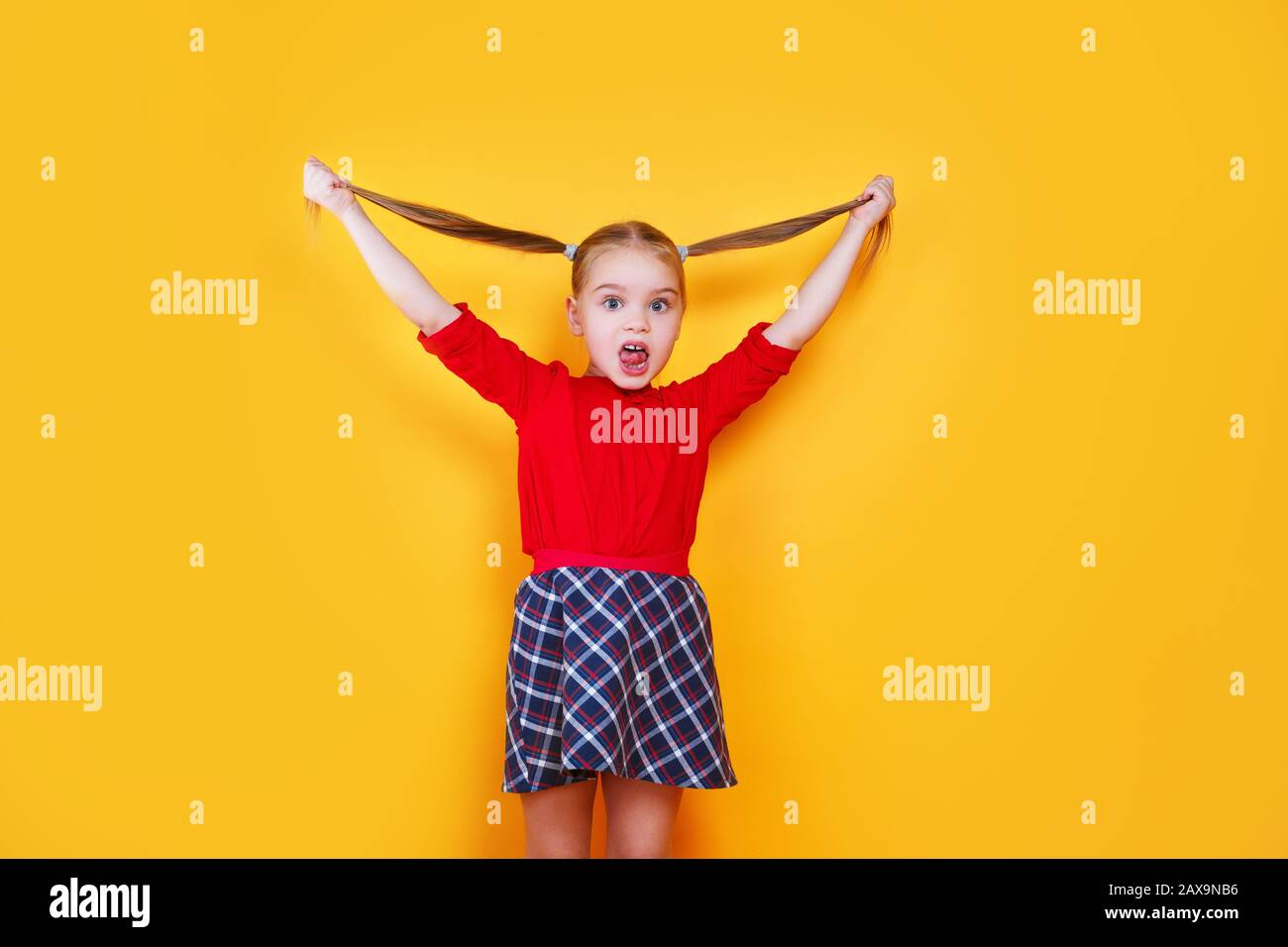 Little girl sticking tongue out happy with funny expression. Emotion concept. Stock Photo