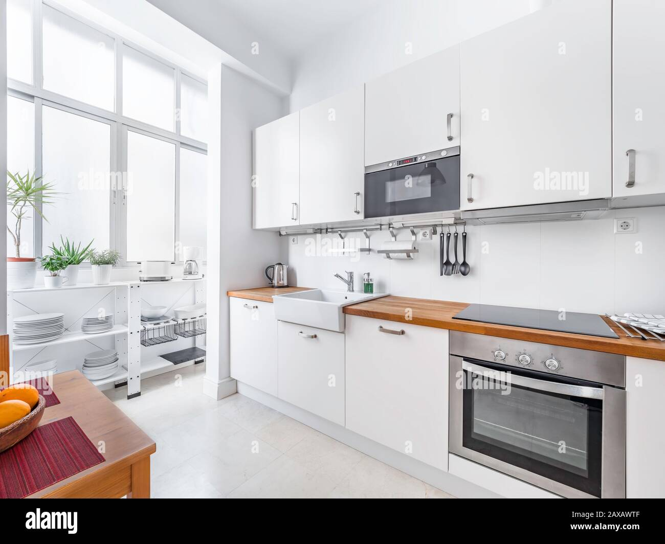 New Stylish Bright Kitchen With White Cabinets Spacious Modern Interior With Wooden Table Chairs Picture Frame And Big Windows Stock Photo Alamy