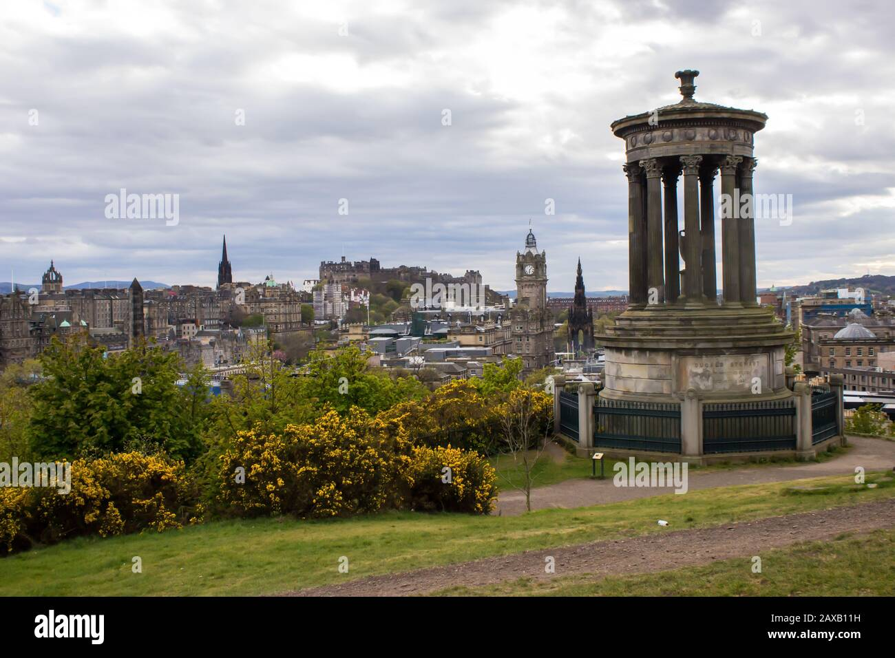 The Dugald Stewart Monument, on Calton Hill, on a spring afternoon with a spectacular view of Castlerock and the Edinburgh Old Town Stock Photo