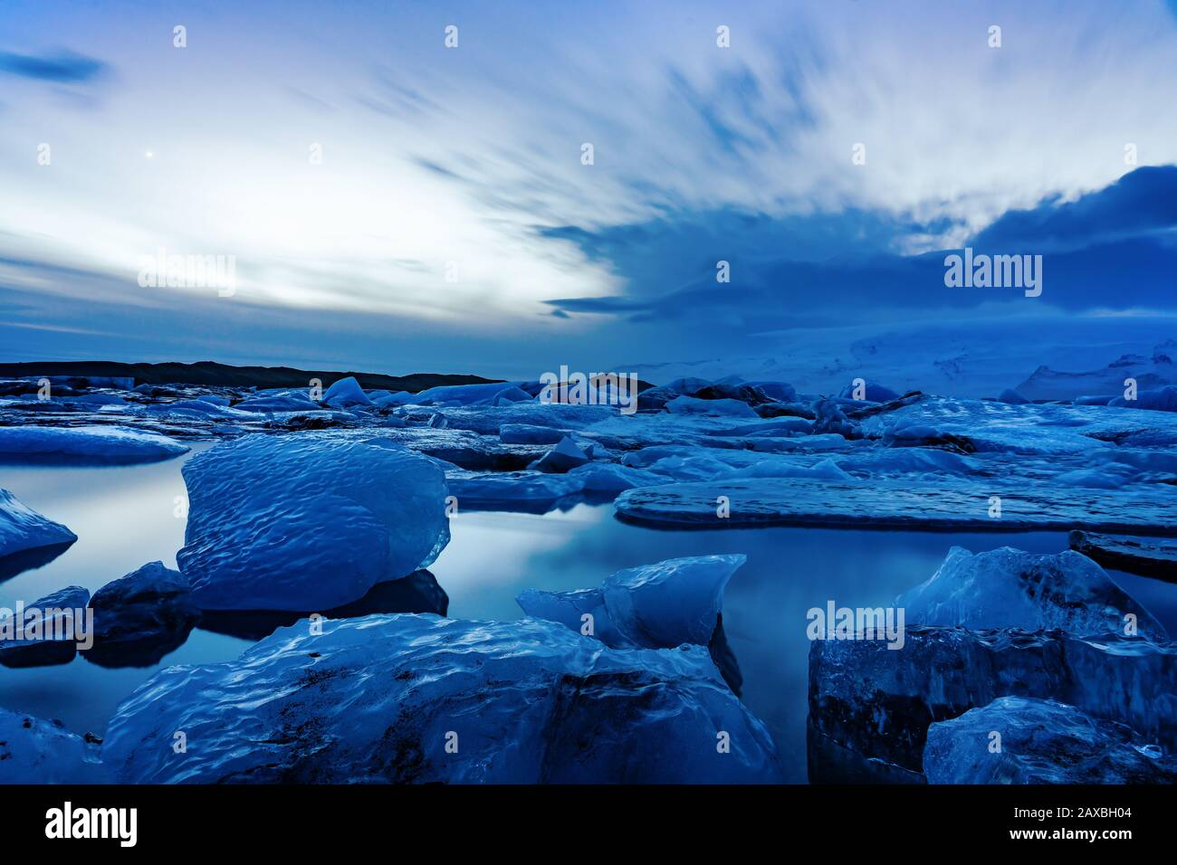 Cold iceland glacier jokulsarlon in the evening icebergs floating on the cold peaceful water after sunset Stock Photo
