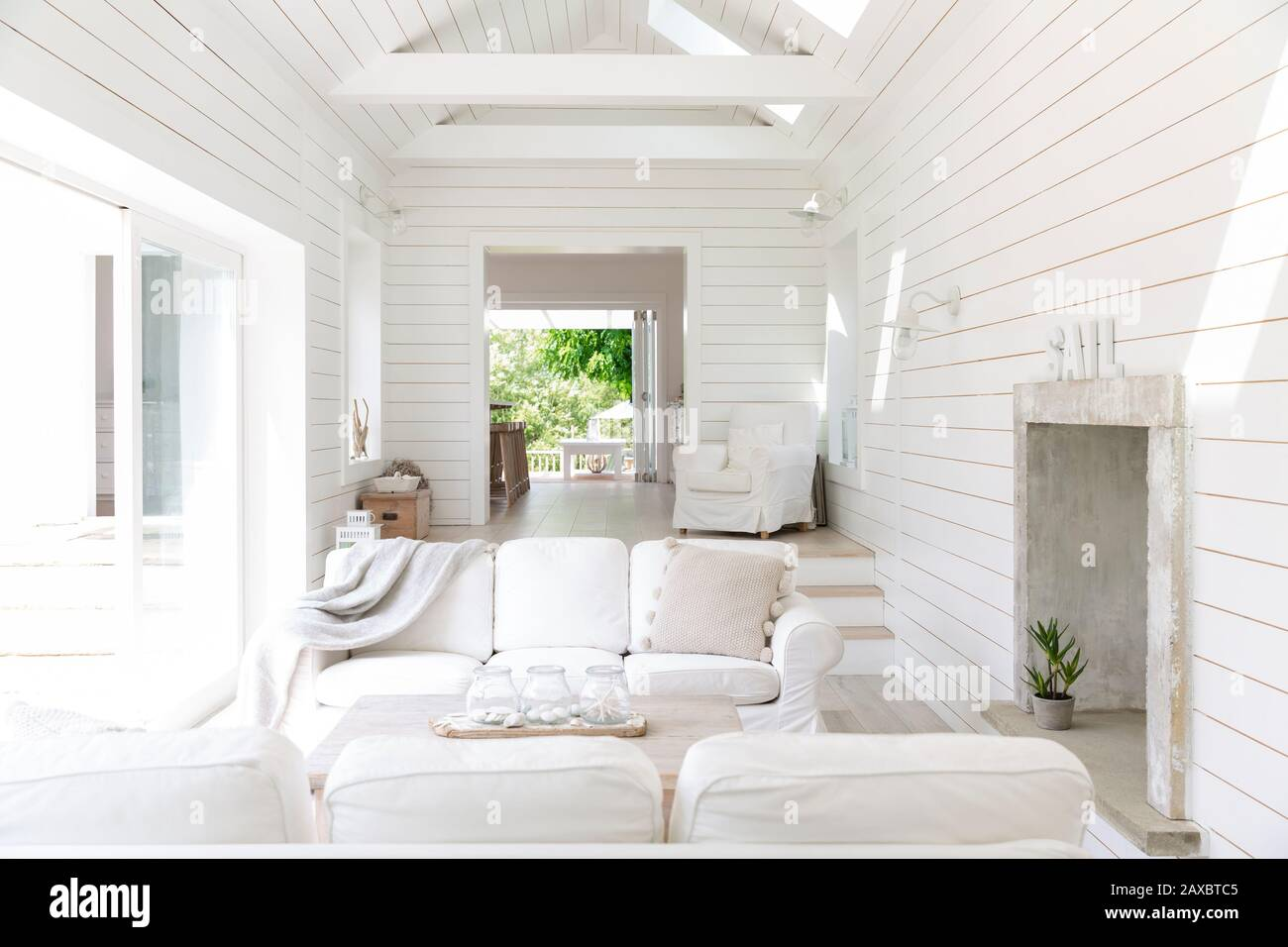 White wood shiplap home showcase beach house living room Stock Photo