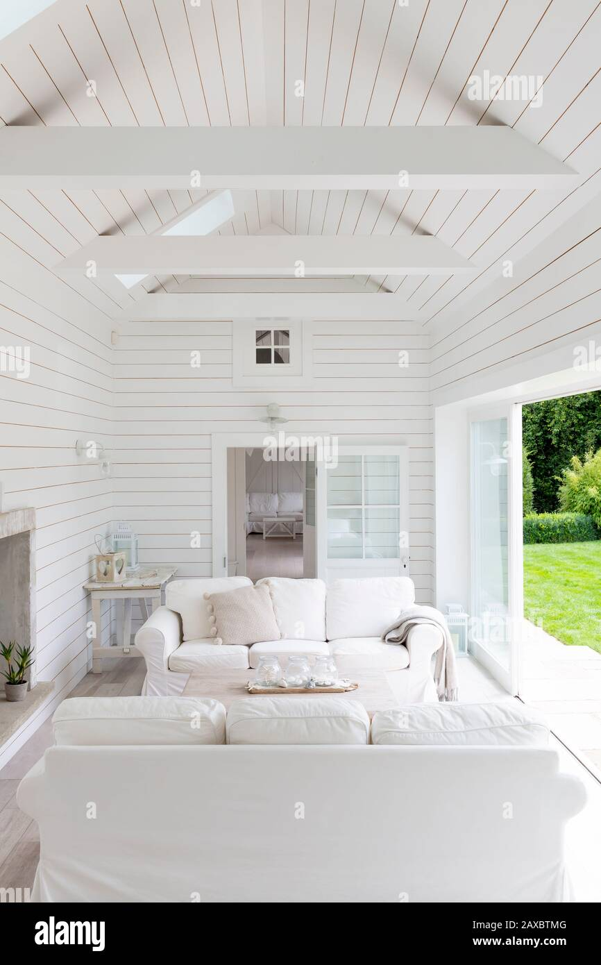White wood shiplap a-frame home showcase living room Stock Photo