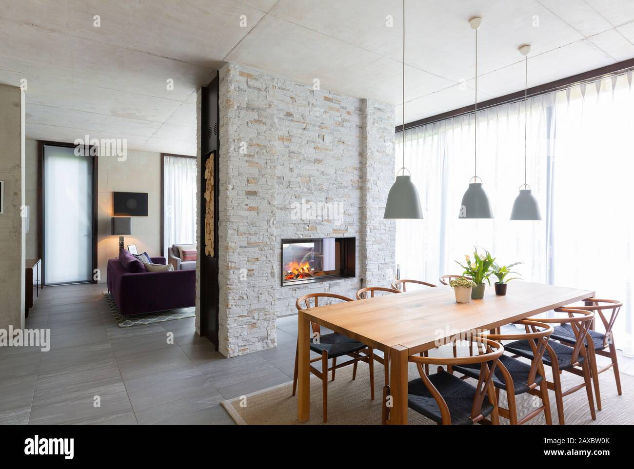 Pendant lights over dining table in modern dining room with ...