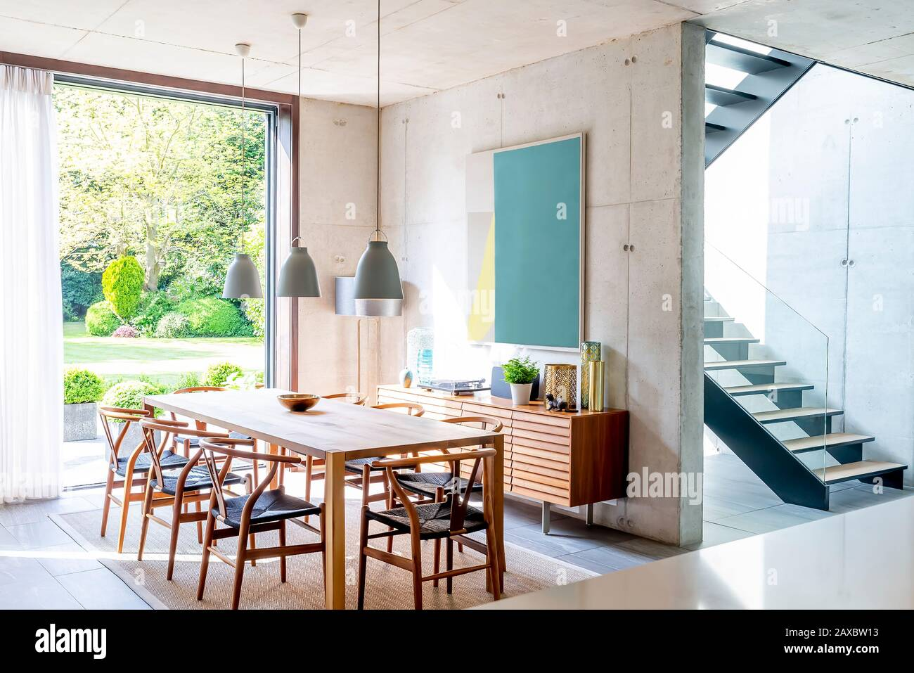 Pendant Lights Over Dining Table In Modern Dining Room Stock Photo Alamy