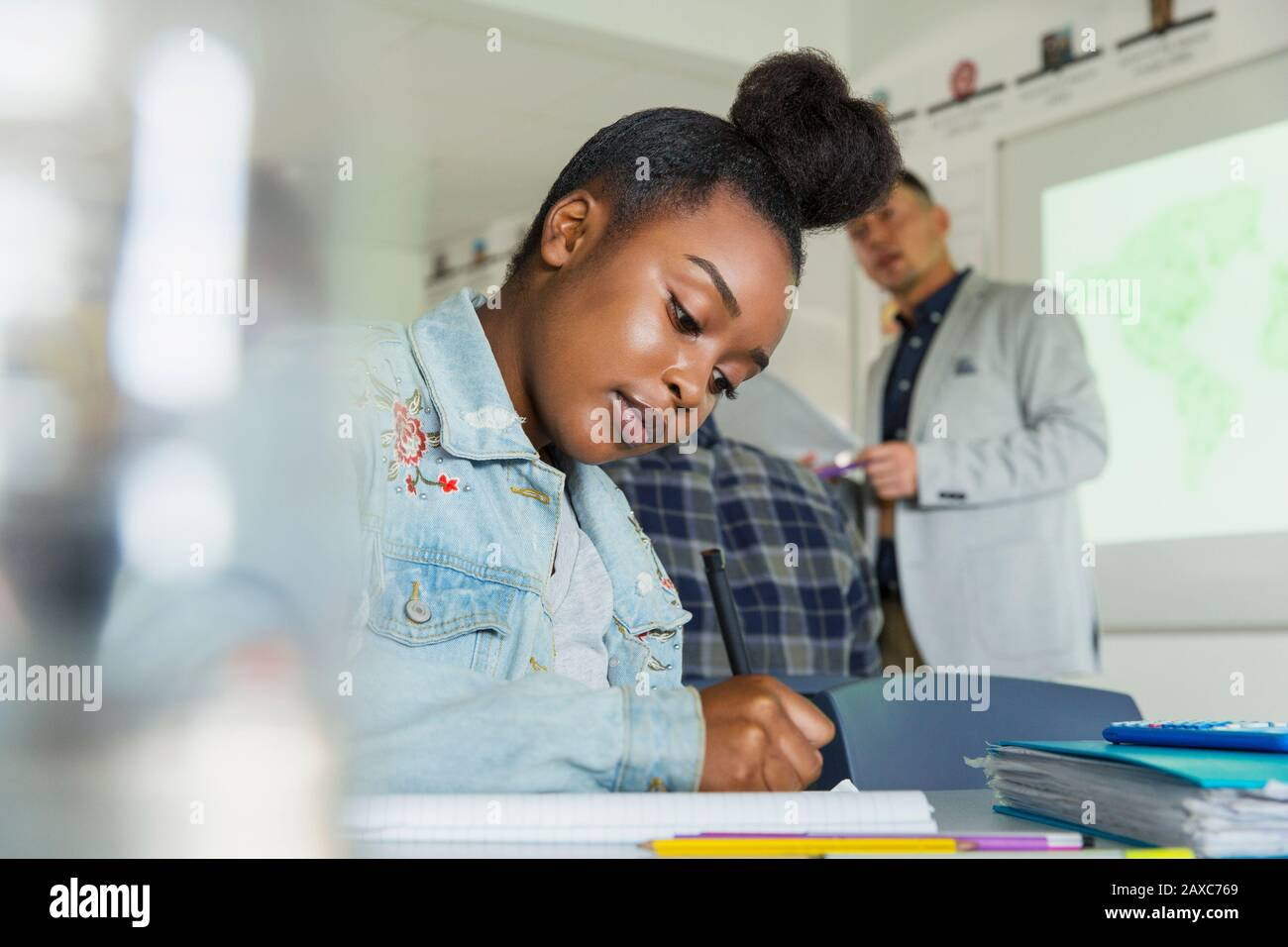 Focused high school girl student studying in classroom Stock Photo