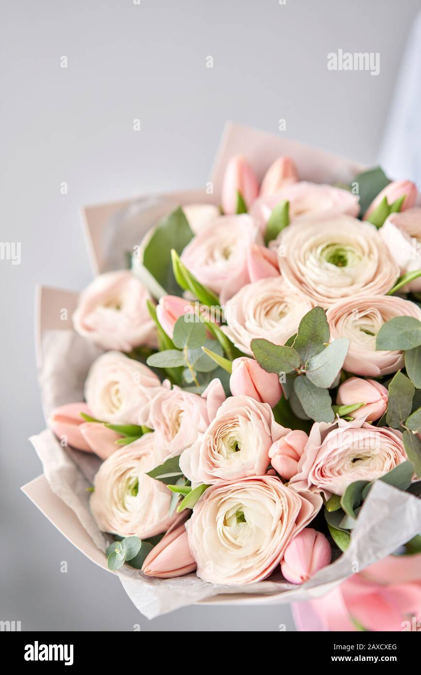 Bunch Pale Pink Tulips And Ranunculus Flowers With Green Eucalyptus The Work Of The Florist At A Flower Shop Stock Photo Alamy