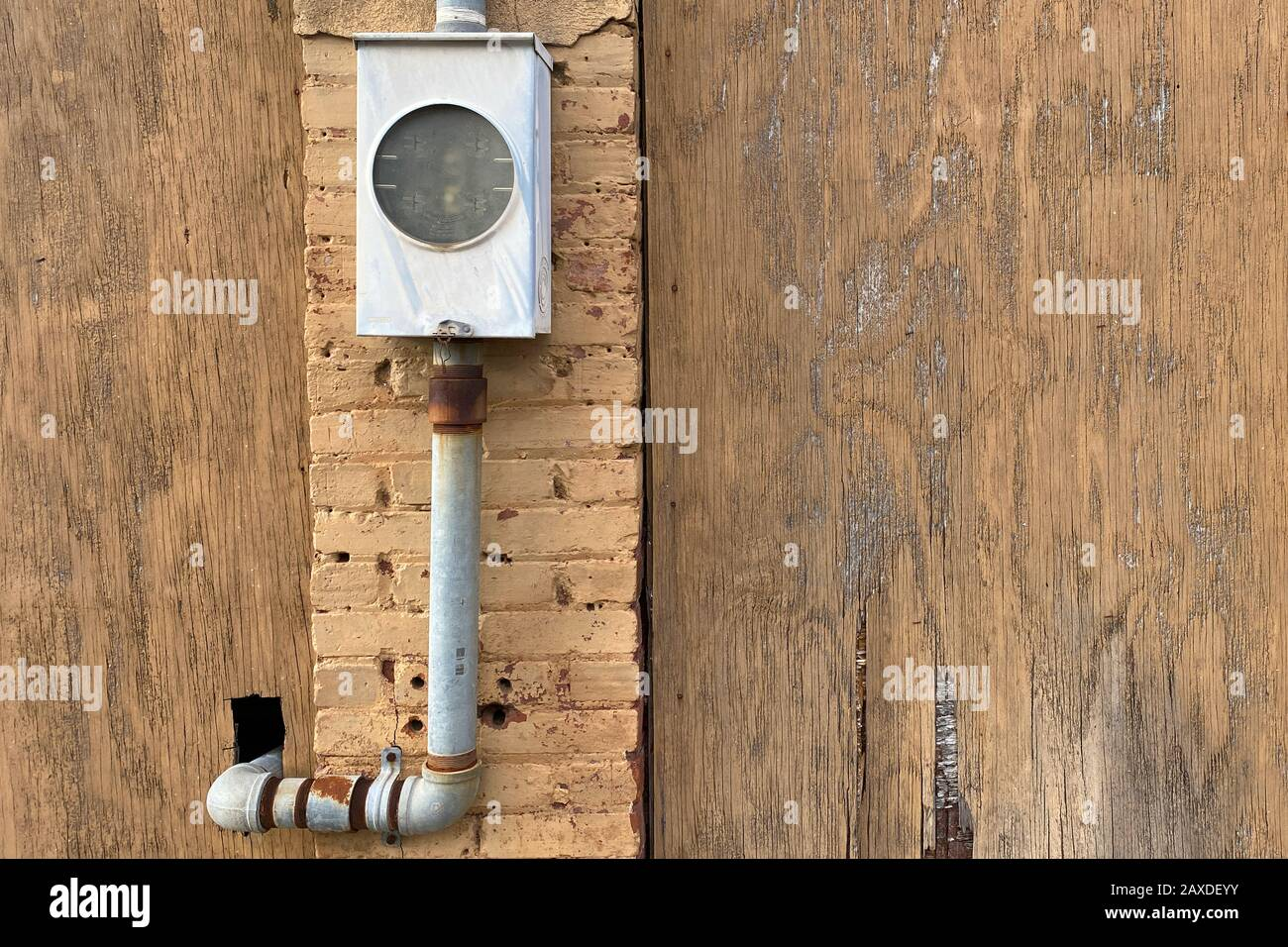 an unused rusty alley wall utility box Stock Photo