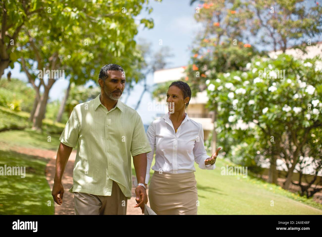 Couple in deep discussion while walking. Stock Photo