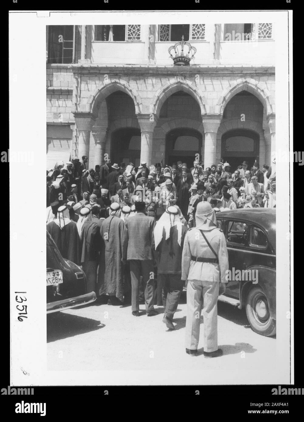 """""""English: Title: 'Coronation' of King Abdullah in Amman. Crowds at palace awaiting king's return from the mosque Abstract/medium: G. Eric and Edith Matson Photograph Collection  Physical description: 1 transparency:; 1946; Library of Congress Catalog: https://www.loc.gov/pictures/collection/matpc/item/mpc2005010235/PP Original url: https://hdl.loc.gov/loc.pnp/matpc.14991; Matson Collection; """" Stock Photo"""