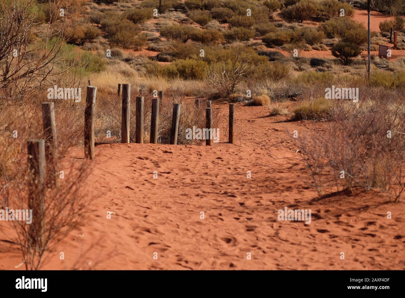 Lookout trail, scurb posts red dirt at Yulara, Sails In The Desert resort. It's really in the desert. Stock Photo