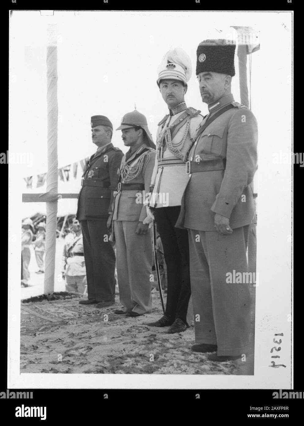 """English: Title: 'Coronation' of King Abdullah in Amman. King Abdullah, Emir Abdul Illah, (Regent of Iraq), Emir Naif, (King Abdullah's youngest son) and Nuri Pasha Said, Iraqi ambassador at large Abstract/medium: G. Eric and Edith Matson Photograph Collection  Physical description: 1 transparency :; 1946; Library of Congress Catalog: https://www.loc.gov/pictures/collection/matpc/item/mpc2005010233/PP Original url: https://hdl.loc.gov/loc.pnp/matpc.14989; Matson Collection; "" Stock Photo"