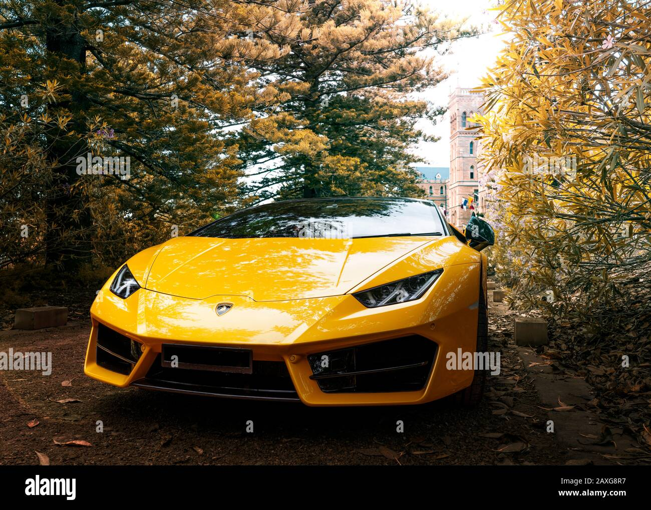 Yellow Lamborghini On Display In Manly Sydney In Front Of Historical Vintage Euro Building Stock Photo Alamy