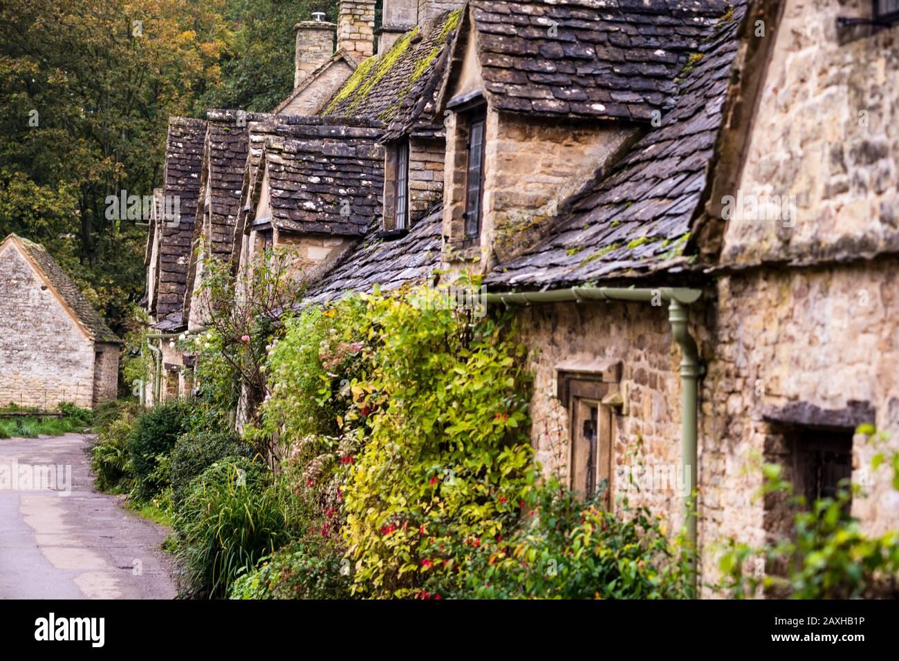 Arlington Row in Bibury, England are quaint 17th century stone cottages. Stock Photo