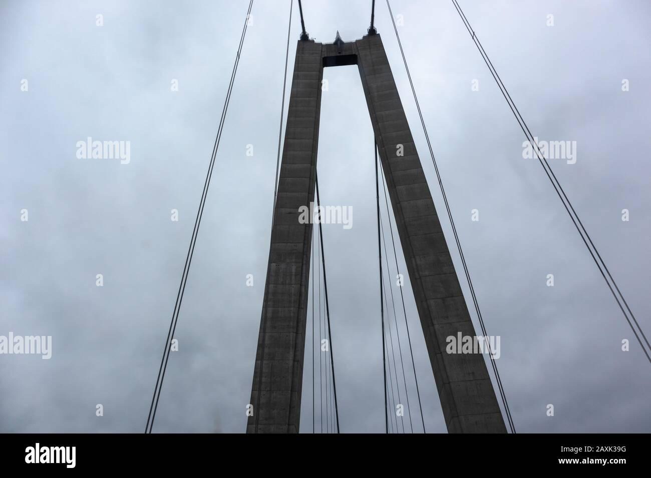 Bridge wire arch on dark dramatic sky scape heavy dark clouds. Swedish highroad northern architecture Stock Photo