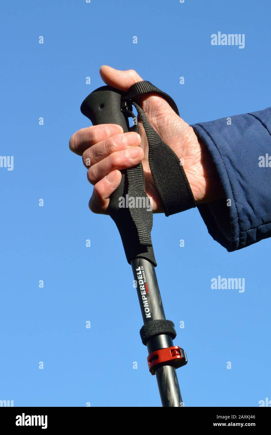 Wrist strap on trekking pole. Incorrect use. Stock Photo