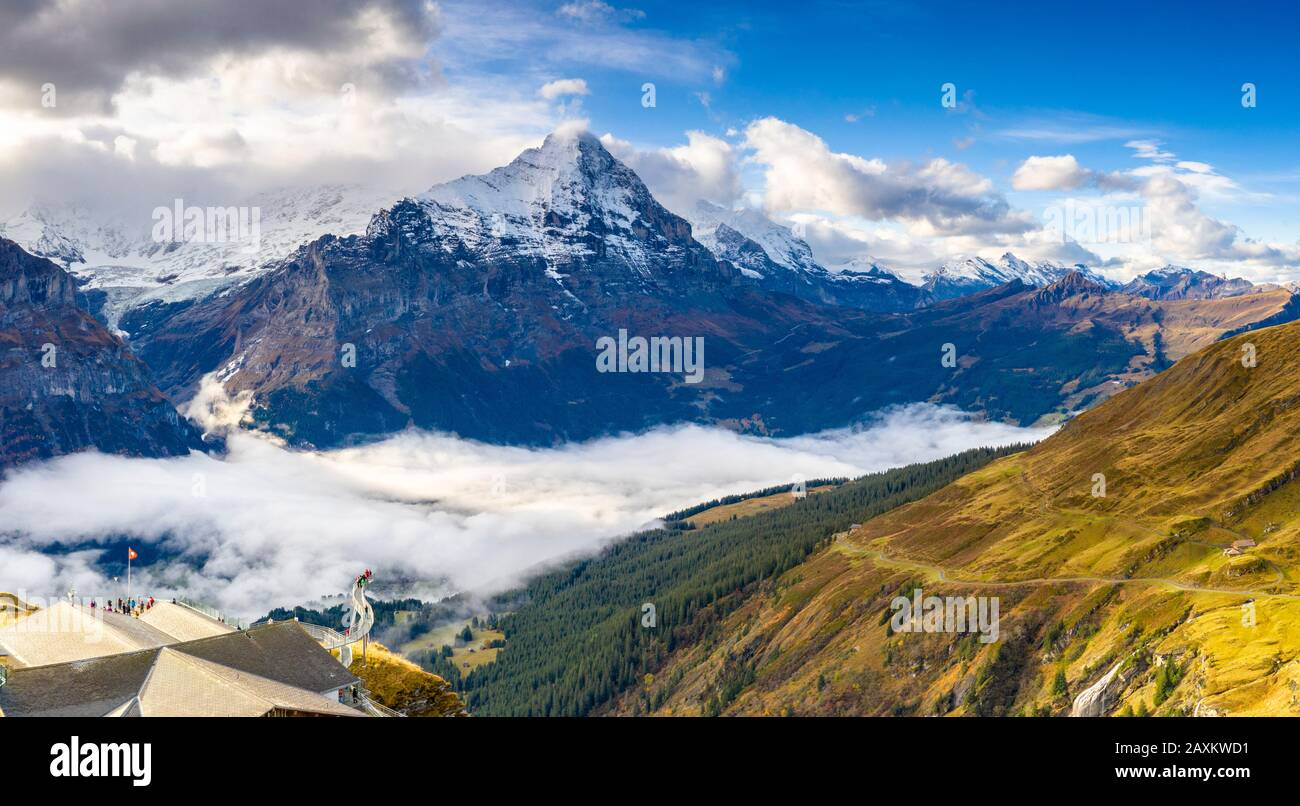 People admiring the autumn landscape from elevated walkway (Cliff Walk by Tissot), First, Grindelwald, Canton of Bern, Switzerland Stock Photo